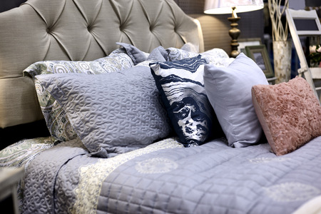 headboard: Bed with bed pillows, decorative pillows, quilt,headboard and nightstand