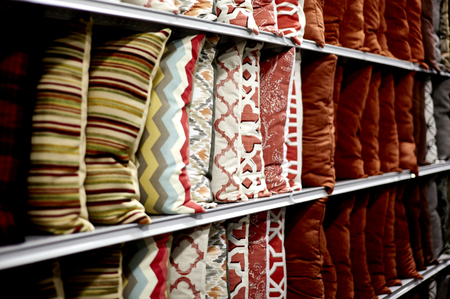 store shelf: Row of decorative pillows on a store shelf