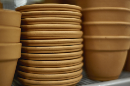 ware house: Stack of Clay Trays for clay pots with shallow depth of field Stock Photo