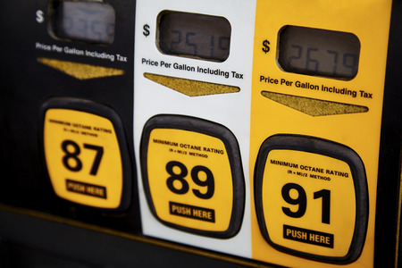 unleaded: Close up of gas pump showing premium gas price with shallow depth of field Stock Photo