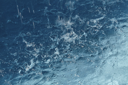 waterdrop: Rain drops falling into a pool of water causing splashing Stock Photo