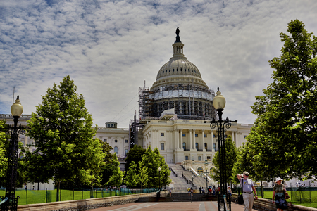 congressional: Washington DC, USA - May 30, 2016: Scaffolding on the dome of the US Capitol Building in Washington DC with tourists on walkway