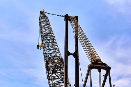 buildingsite: Large crane boom against blue sky