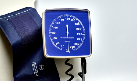 cuff: A wall mounted hospital blood pressure cuff with meter Stock Photo