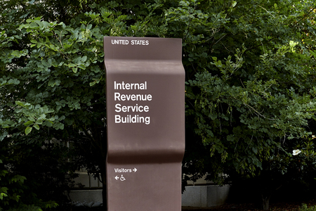 internal revenue service: Sign on corner of Internal Revenue Service Building in Washington DC Stock Photo