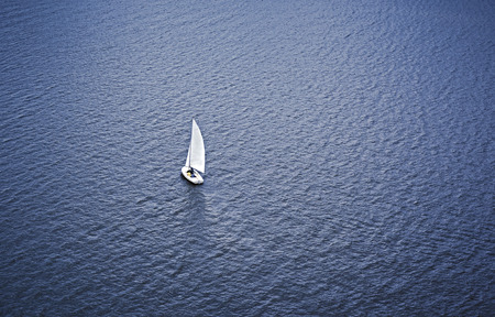 aerial photograph: Aerial photograph of sailboat on water Stock Photo