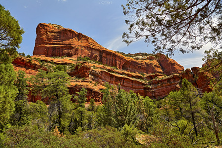 red rock: Red Rock Mountain cliffside in Sedona Arizona with blue sky and clouds