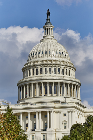 congressional: Washington DC, USA - October 1, 2016: US Capital Building close up of Dome with US Flag Editorial