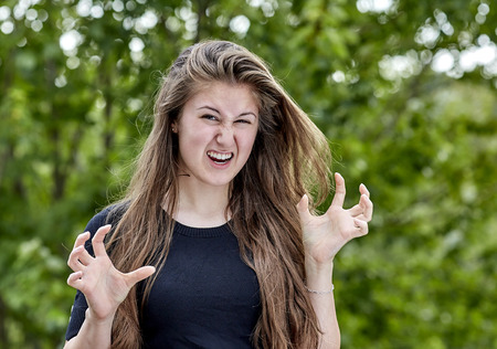 wicked woman: Young woman angry with crazy eyes and wicked expression