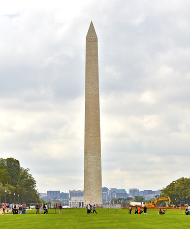 washington monument: Washington DC, USA - October 1, 2016: Washington Monument with tourists walking and construction equipment
