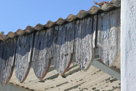 weathered: Weathered wood on edge of building