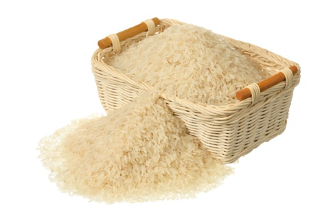 Basket of rice isolated on white background Stock Photo - 9088161