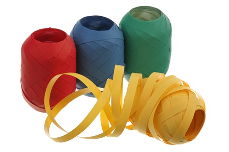 Red, blue, green and yellow ribbons over white background  photo