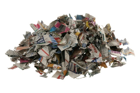 Paper for recycling - newspaper scraps are isolated on a white background