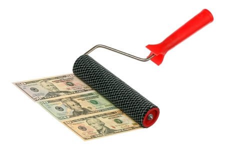 Paint roller and money are isolated on a white background Stock Photo - 9151020