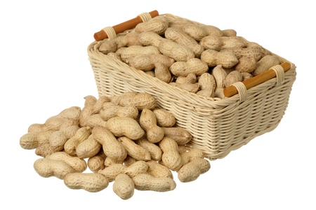 Peanuts with shells on the basket isolated on white Stock Photo - 9191292
