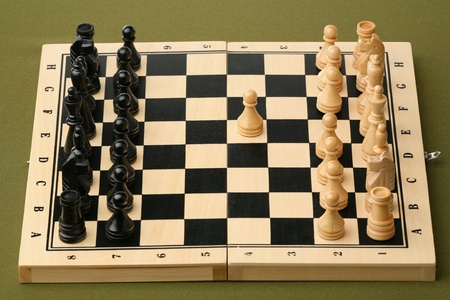 Chess opening on a green table  photo