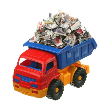 Paper for recycling in the truck are isolated on a white background