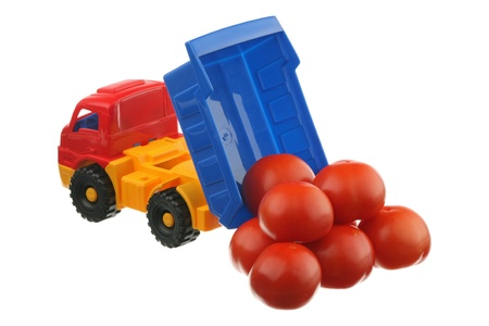 Tomatoes and the truck are isolated on a white background  photo