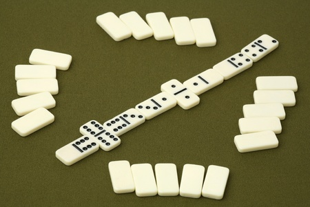 Dominoes - white dice on a green background  Stock Photo