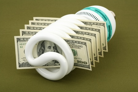 Fluorescent lamp and US dollars on a green background