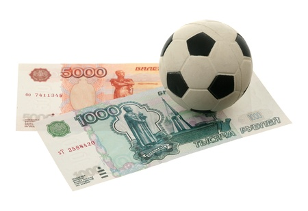 Soccer ball and russian money over white background  photo
