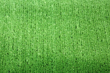 Green background - an artificial lawn with a short grass  Stock Photo - 9382545