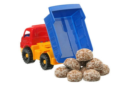 Spice-cakes and the truck are isolated on a white background  photo