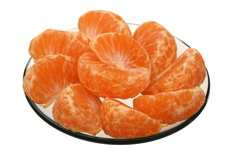 Tangerine slices in a glass plate on a white background  photo