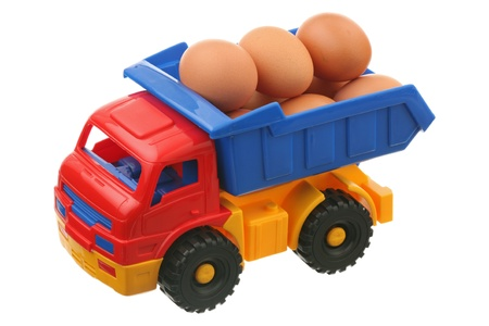 Eggs and the truck are isolated on a white background