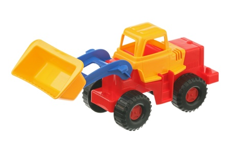 The toy bulldozer is isolated on a white background