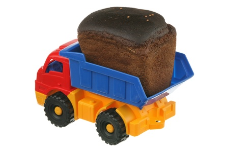 Brown bread and the truck are isolated on a white background  Stock Photo