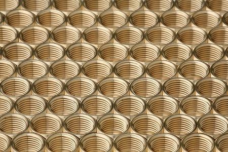 accurately: Interesting background of accurately laid brass nuts  Stock Photo