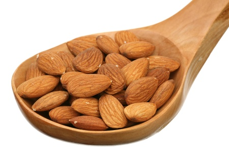 Almonds in a wooden spoon on a white background