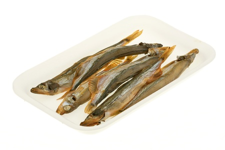 Dried capelin in the plastic container