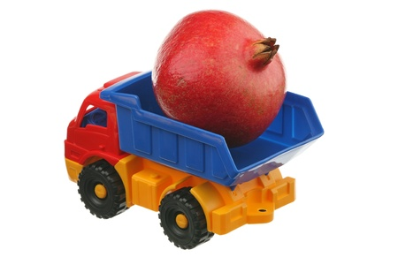 The big pomegranate in the truck it is isolated on a white background  photo