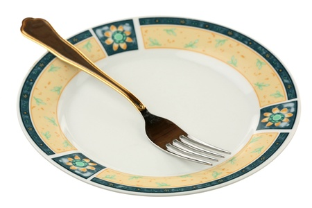 Dinner fork on a plate are isolated on a white background  Stock Photo - 9499106