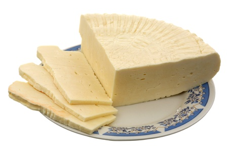 Georgian cheese on a ceramic plate it is isolated on a white background  photo