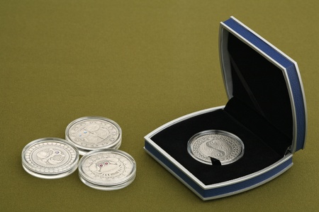 Collection silver coins on a green background