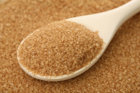 Brown sugar in a wooden spoon  Stock Photo