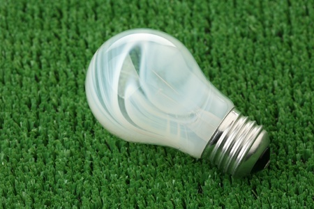fused: The bulb has fused on a green background of artificial grass
