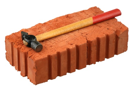 Hammer and red brick - It is isolated on a white background.  photo