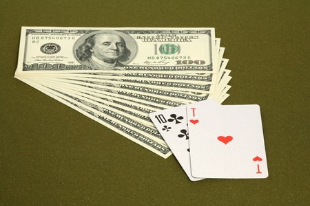 Playing cards and money on a green table  Stock Photo - 9755398