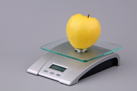 Yellow apple on scales  Stock Photo
