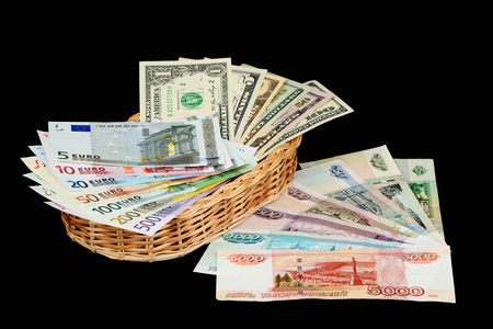 Dollars, euro and roubles on a black background