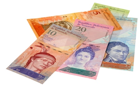 The pile of money of Venezuela is isolated on a white background photo