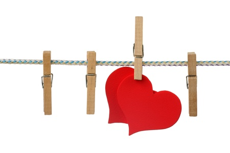 Two red hearts dry on clothesline  photo