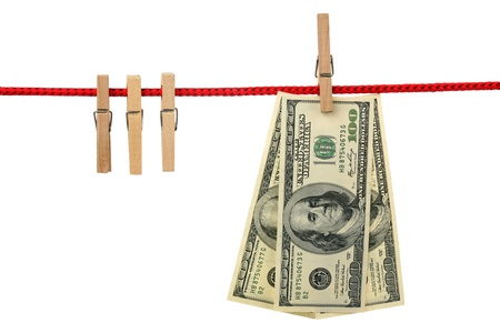 Dollars are hanging on a wooden clothespin isolated on white background  photo