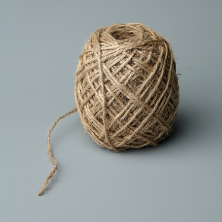 Ball of a twine on a gray background  Stock Photo