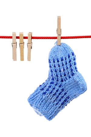 Socks and wooden clothespins on clothesline isolated on white background Stock Photo